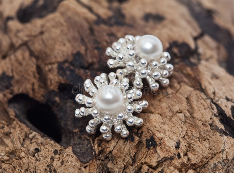 Sterling silver earrings with white pearl stock photos
