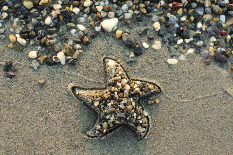 Stern auf dem Strand stockbilder