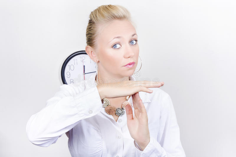 Female Business Executive Showing Time Out Gesture