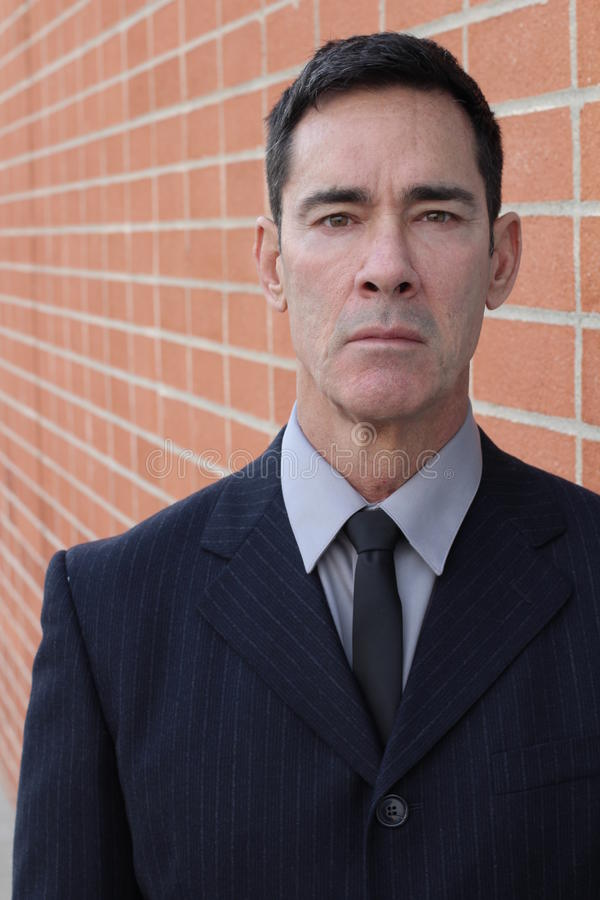 Stern looking businessman close up stock photo