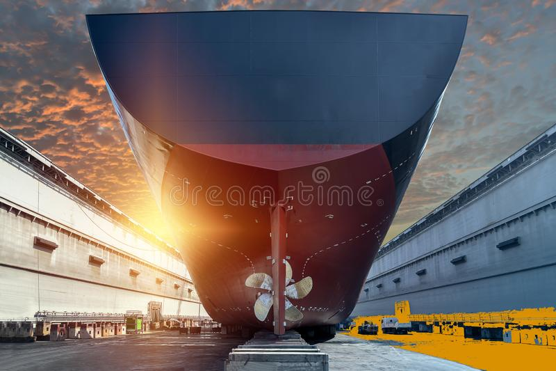 Stern ship with propeller rudder in floating dock. Cargo ship view of Stern propeller with rudder of big ship Moored on sleeper in floating dry dock in shipyard royalty free stock images