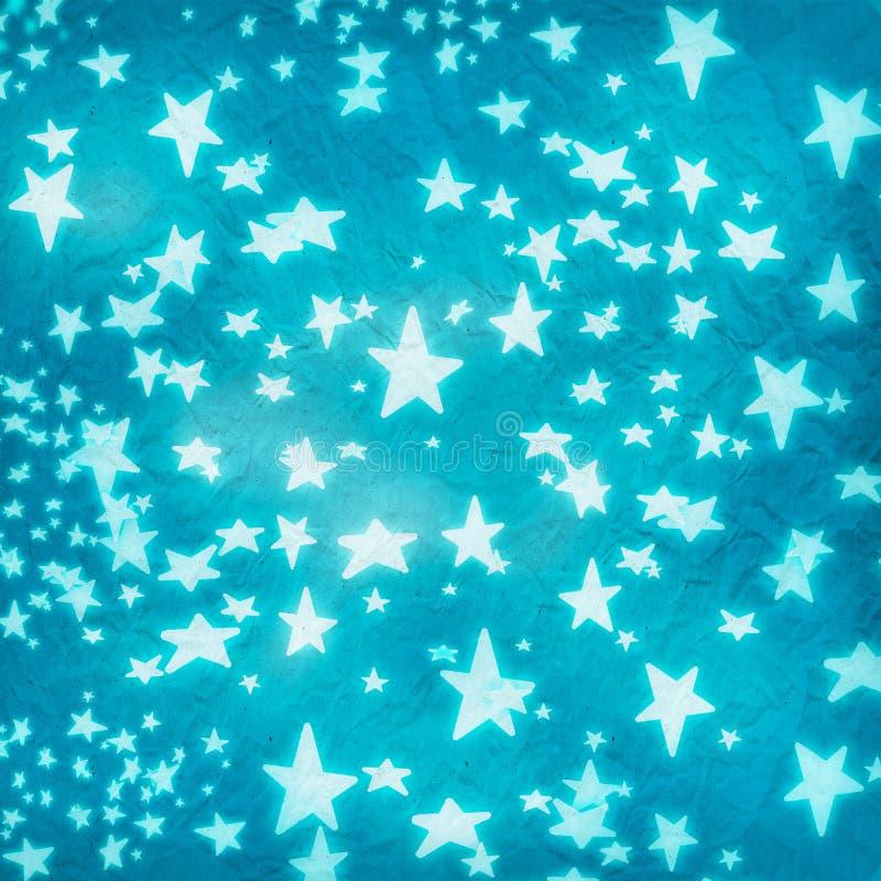 Sterne auf Blau zerknittertem Papier lizenzfreie stockbilder