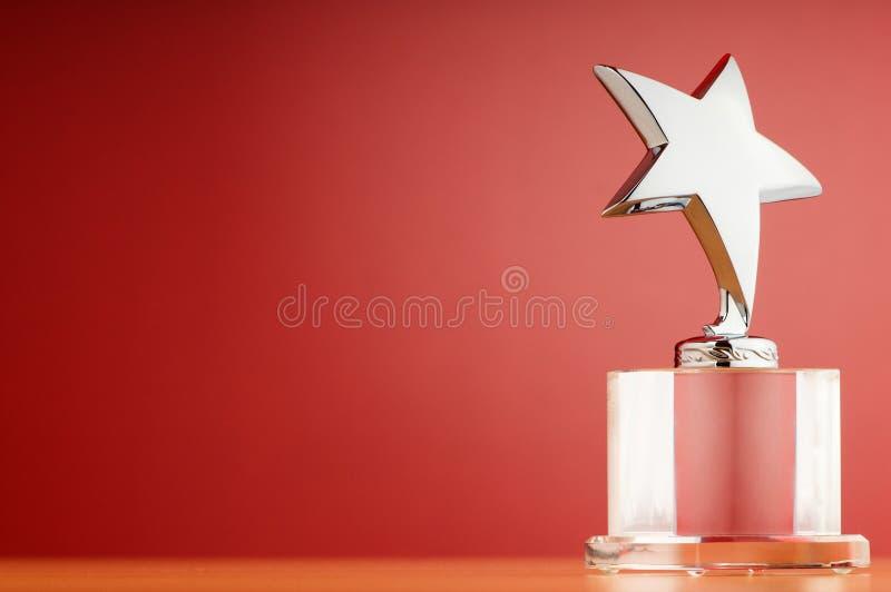 Sternpreis auf dem Steigunghintergrund stockfotografie