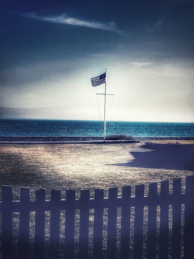 Sterren en Strepen door het Zand en de Branding royalty-vrije stock foto