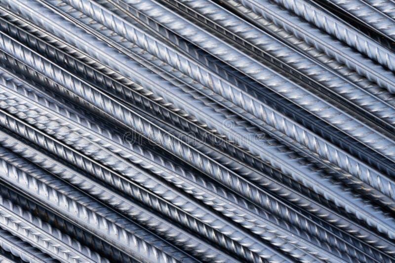 Sterta ciężkiego metalu wzmacnienia bary z okresową profilową teksturą Zamyka w górę stalowej budowy armatury Abstrakcjonistyczny zdjęcia royalty free