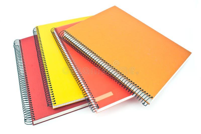 Sterta kolorowi ślimakowaci notatniki obrazy stock