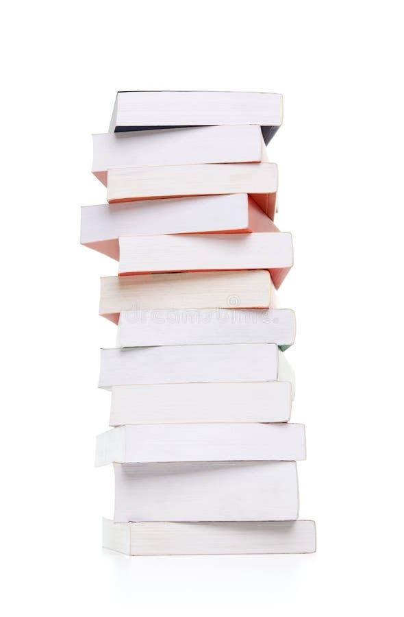 Sterta książki na biel obraz stock
