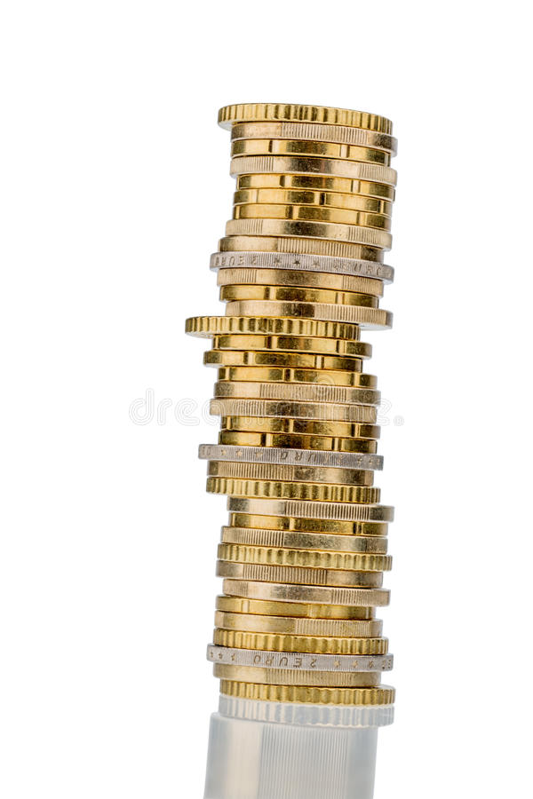 Sterta pieniądze monety przeciw białemu tłu obraz stock