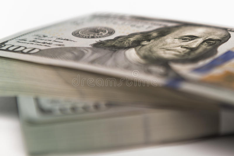 Sterta pieniądze w USA dolarach spienięża banknoty obraz royalty free