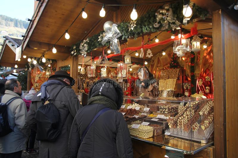 Sterzing chocolate stall. A chocolat stall in the traditional xmas market of vipiteno in italy royalty free stock photos
