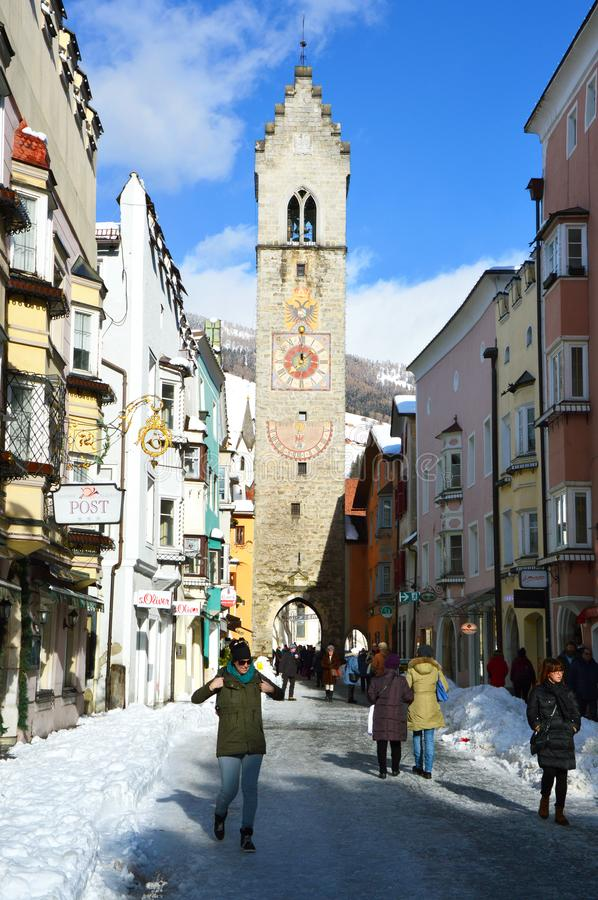 STERZING, ITALY - JANUARY 23, 2018: winter time in cozy mountain town of Europe. Old medieval mountain village with snow. People in main street of Sterzing in stock photos