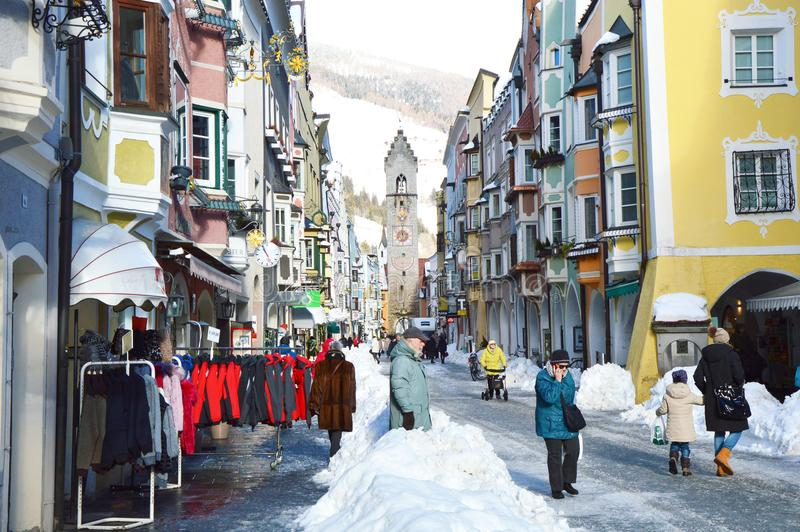 STERZING, ITALY - JANUARY 23, 2018: winter time in cozy mountain town of Europe. Old medieval mountain village with snow. People in main street of Sterzing in stock photo