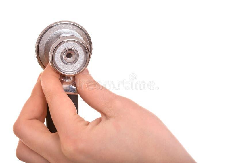 Stethoscoop en hand. De apparatuur van de geneeskunde. stock afbeelding
