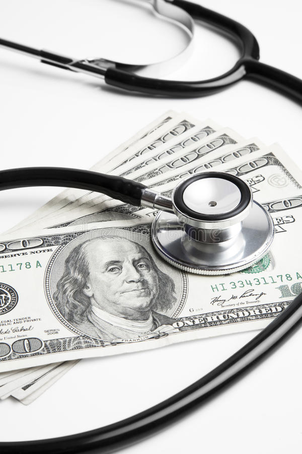 Stethoscope and 100 dollar bills royalty free stock image