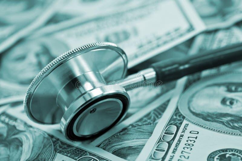 Stethoscope. Medical stethoscope and dollars closeup royalty free stock image
