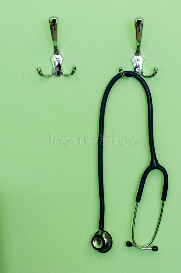 Stethoscope. Hanging on the wall in a waiting room royalty free stock photos