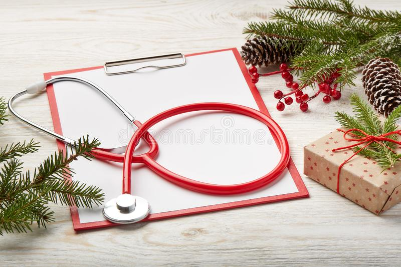 Stethoscope and Christmas decorations. stock photos