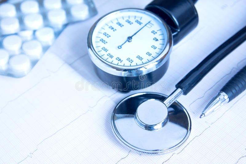 Stethoscope, blood pressure monitor, pills royalty free stock image