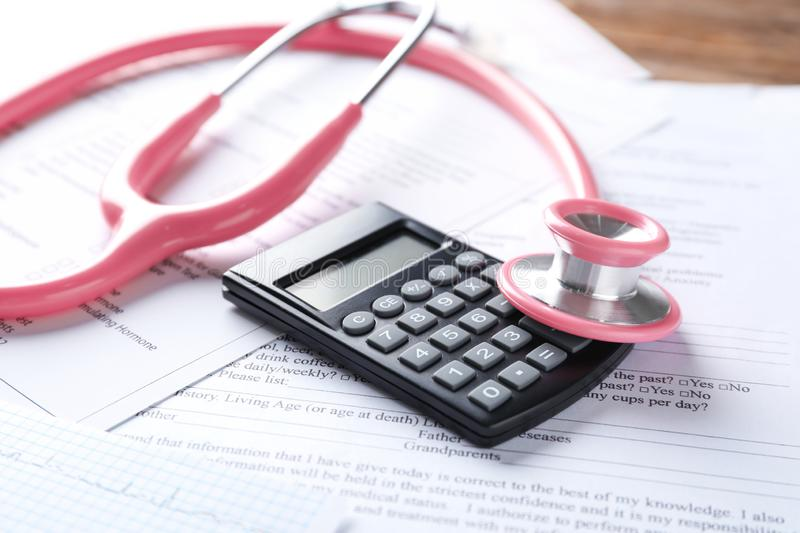 Stethoscope with calculator on documents. Health care concept royalty free stock photography