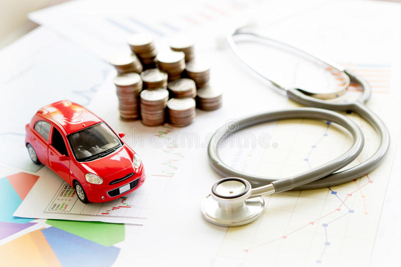 A stethoscope car graph and coin. Stethoscope car graph and coin royalty free stock photo