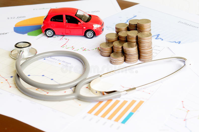 A stethoscope car graph and coin. Stethoscope car graph and coin stock images