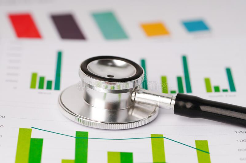 Stethoscope, on charts and graphs paper, Finance, Account, Statistics, Investment, Analytic research data economy stock image