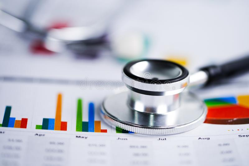Stethoscope, Charts and Graphs spreadsheet paper, Finance, Account, Statistics, Investment, Analytic research data economy. Stethoscope, Charts and Graphs stock photos