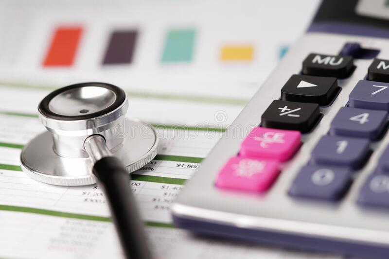 Stethoscope on charts and graphs spreadsheet paper stock photo