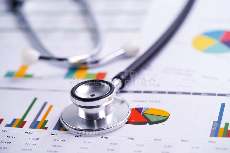 Stethoscope, Charts and Graphs spreadsheet paper, Finance, Account, Statistics, Investment, Analytic research data economy. Stethoscope, Charts and Graphs stock images