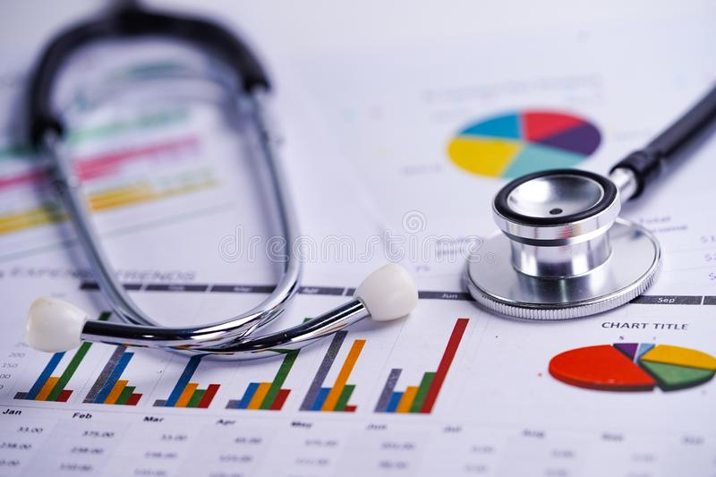 Stethoscope, Charts and Graphs spreadsheet paper, Finance, Account, Statistics, Investment, Analytic research data economy stock image