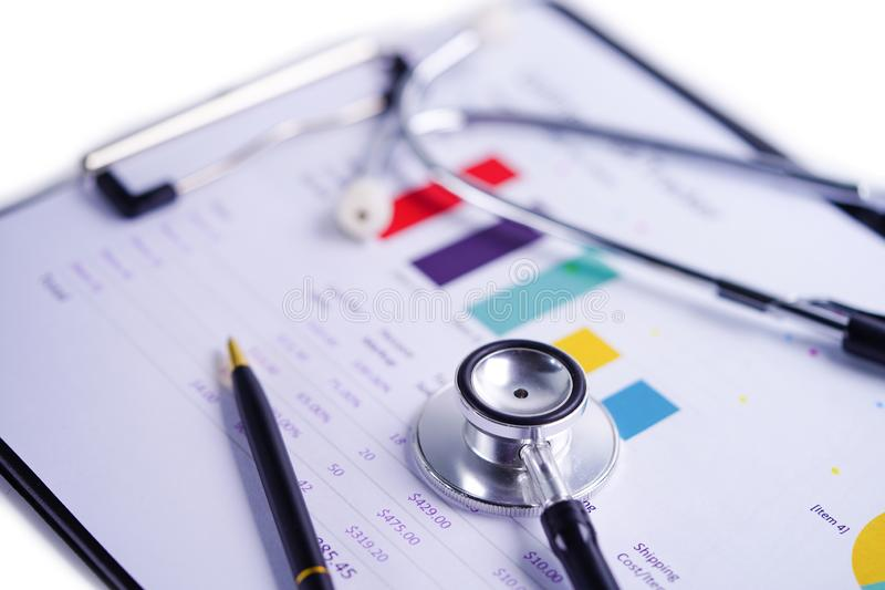 Stethoscope on Charts and Graphs spreadsheet paper. royalty free stock image