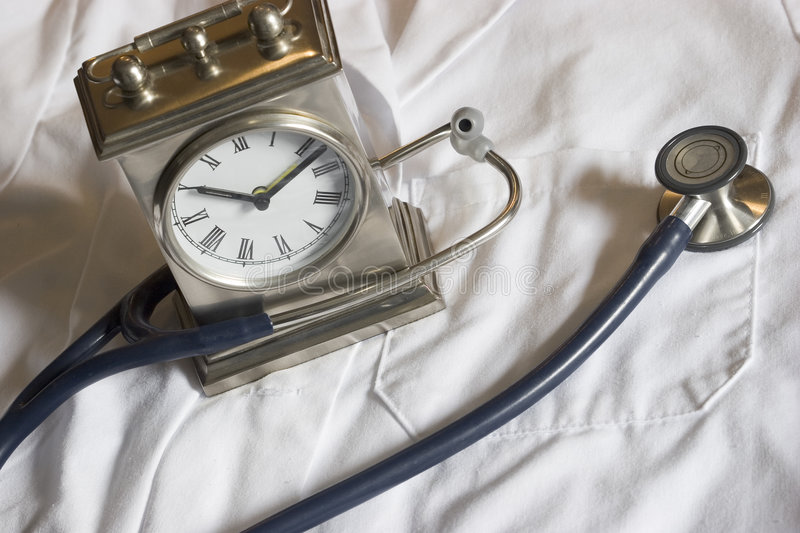 Stethoscope And Clock Royalty Free Stock Image