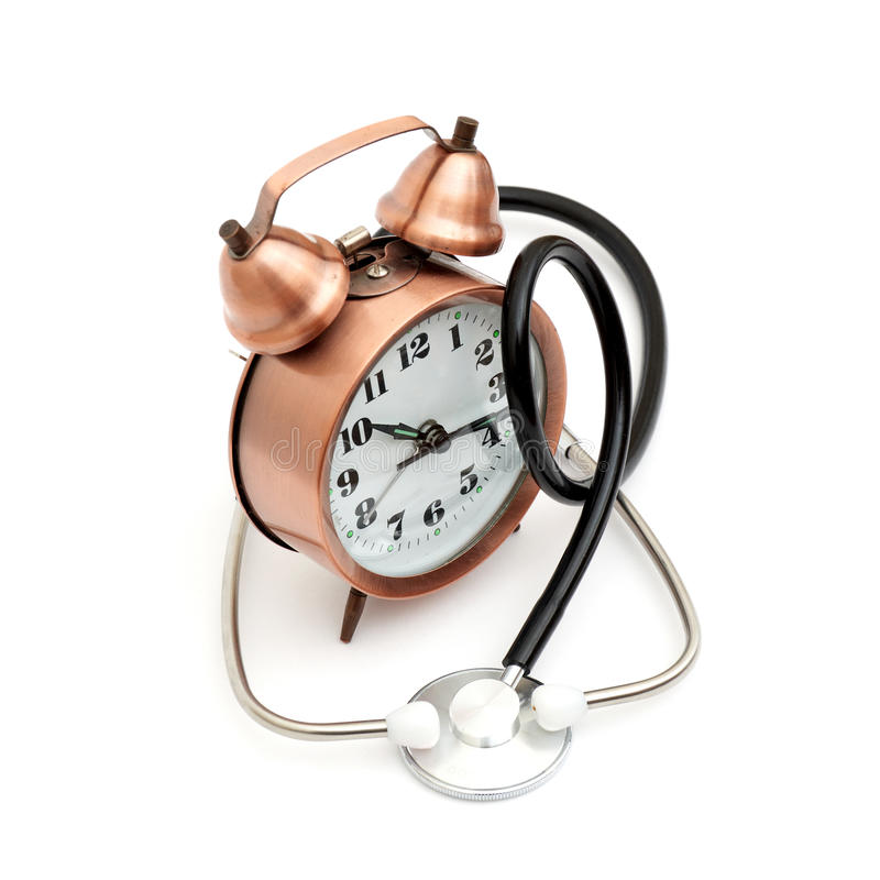Stethoscope and clock. Isolated on white background royalty free stock photos
