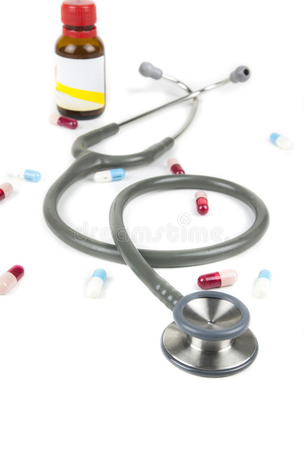 Stethoscope and colorful pills royalty free stock images