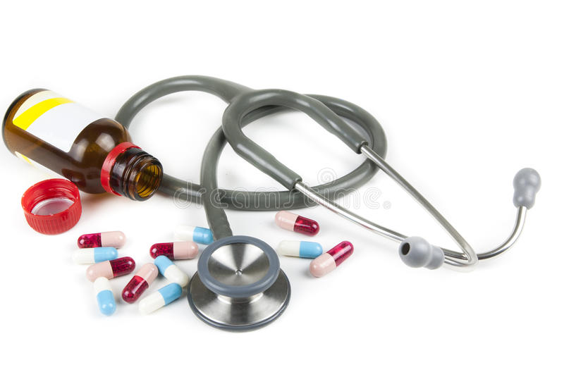Stethoscope and colorful pills stock image