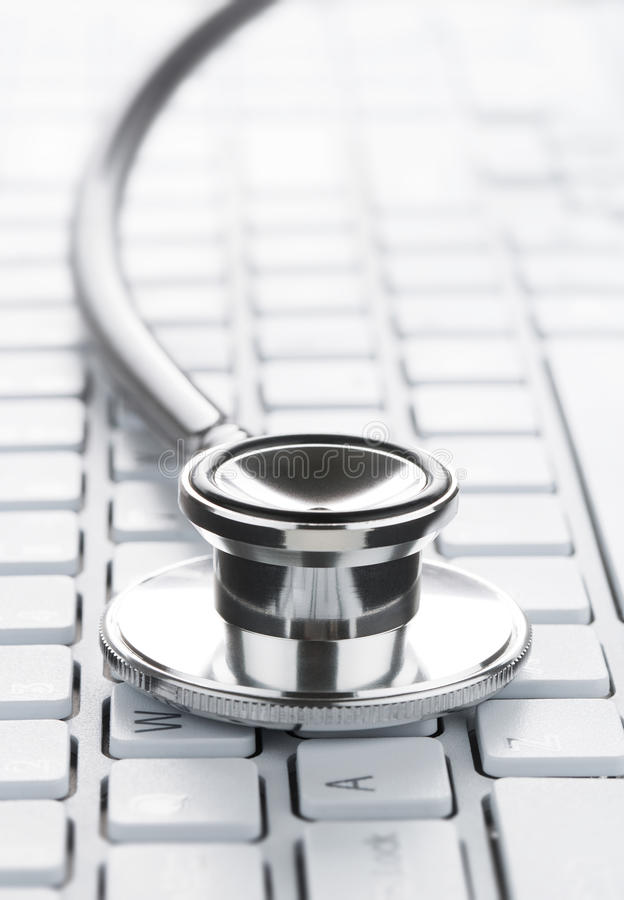 Stethoscope on the computer keyboard royalty free stock photography