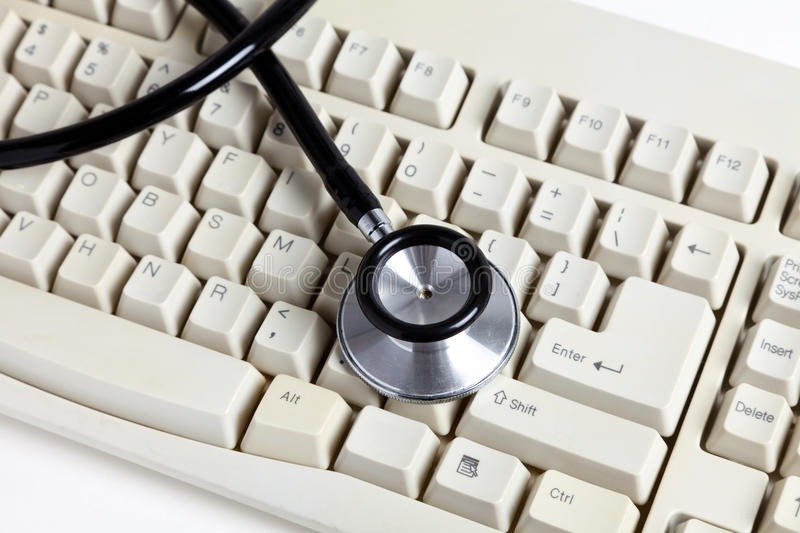 Stethoscope and Computer Keyboard. Concept of Healthcare And Medicine stock images