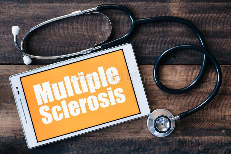 Stethoscope and digital tablet with MULTIPLE SCLEROSIS word on it screen. Healthcare and medical concept stock images