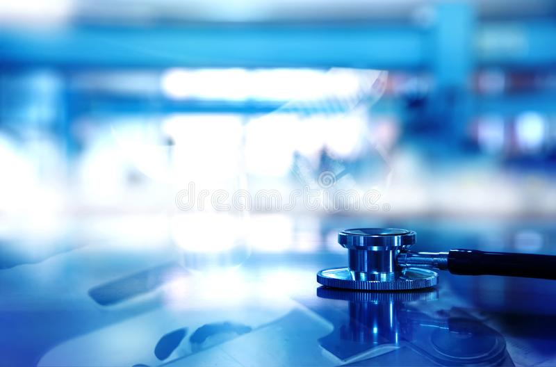 Stethoscope for doctor diagnosis with microscope background in b royalty free stock photo