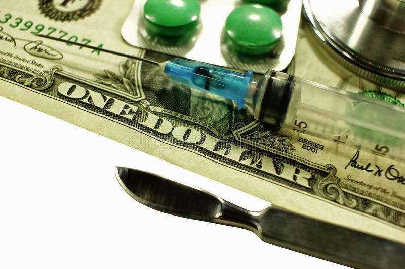 Stethoscope dollar , expenditure on health or financial assistance. High cost of expensive drug concept. Economic forecast of the dollar rate in the world stock photo