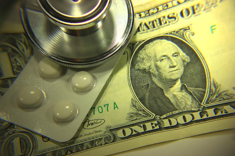 Stethoscope dollar , expenditure on health or financial assistance. High cost of expensive drug concept. Economic forecast of the dollar rate in the world royalty free stock photos
