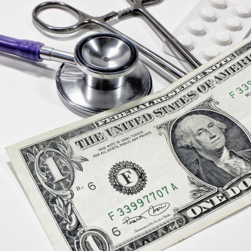 Stethoscope dollar , expenditure on health or financial assistance. High cost of expensive drug concept. Economic forecast of the dollar rate in the world royalty free stock photo