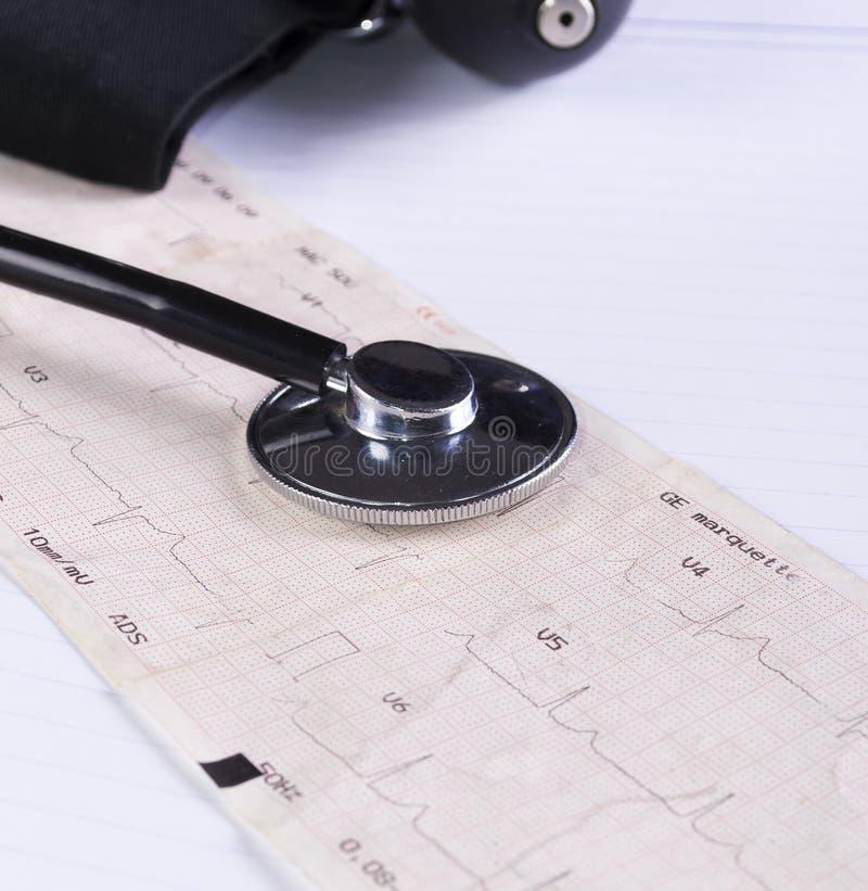 Stethoscope on the ecg. Close up stock photos