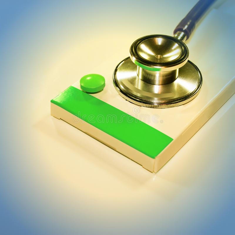 Stethoscope , expenditure on health or financial assistance. High cost of expensive drug concept. Economic forecast of the dollar rate in the world market royalty free stock photography