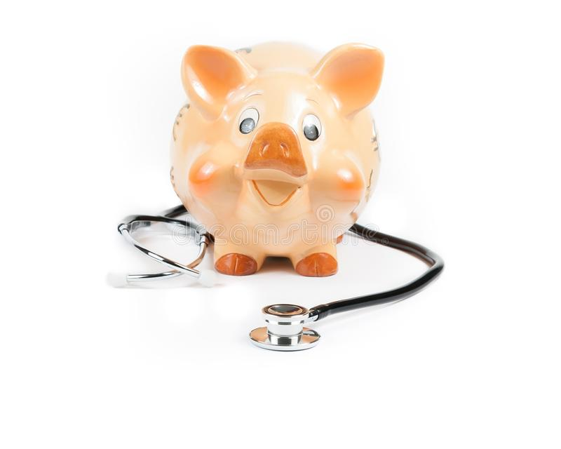 Download Stethoscope In Front Of Piggy Bank A Piggy Bank, Concept For Save Money Stock Photo - Image: 36778330