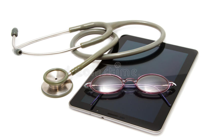 Stethoscope and glasses rest on tablet