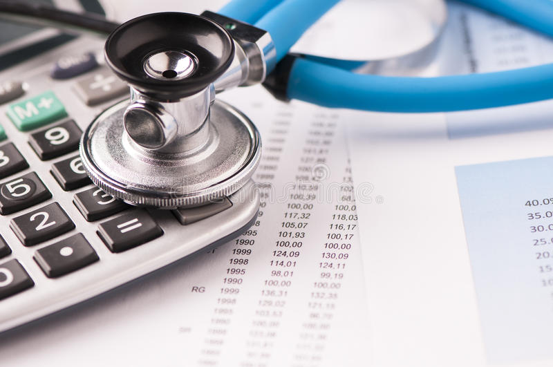 Stethoscope on a graphic charts stock photos
