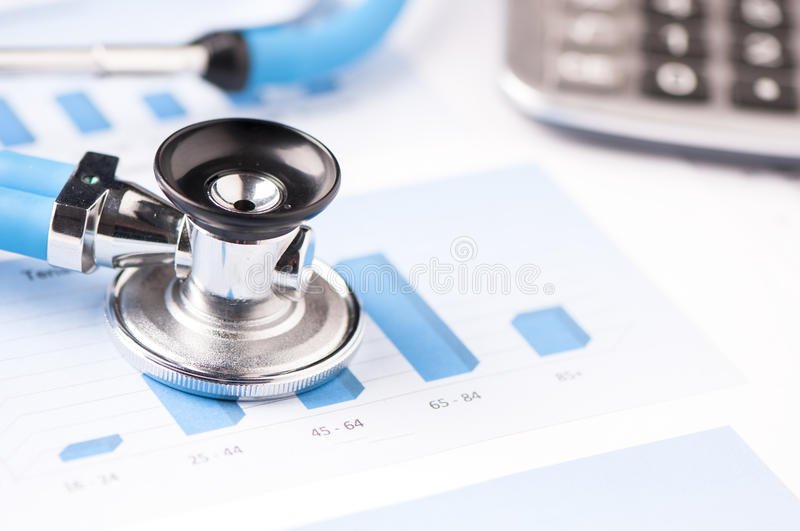 Stethoscope on a graphic charts royalty free stock photo
