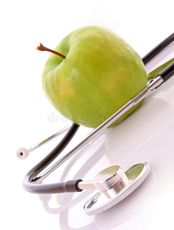 Stethoscope and green apple stock photos