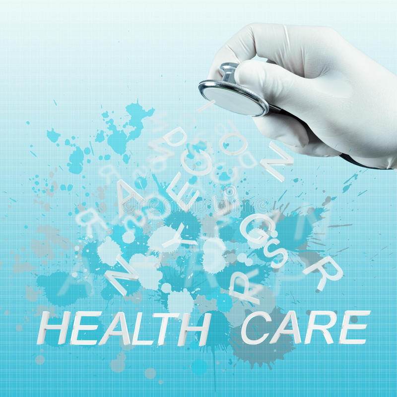 Stethoscope in hand with health care word stock photos
